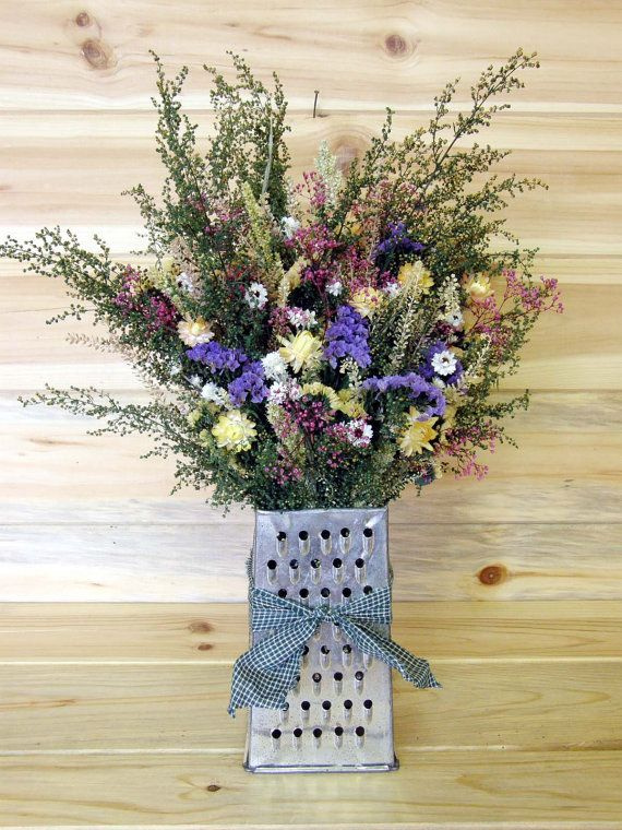♥ ~ dried flowers arrangement in an old grater