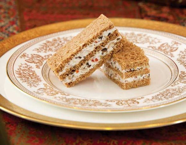 Cream cheese blended with chopped olives and pecans makes for a lovely spread in this recipe for delicious finger sandwiches.