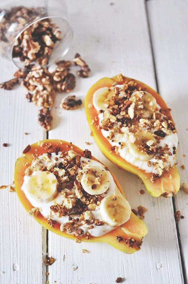 filled papaya boats with quark and fruit topped with banana, granola and honey