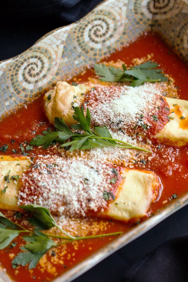 "NYT Cooking: For many Italian-American families, in New Jersey and elsewhere, the Thanksgiving smorgasbord doesn't feel quite right without a little touch of red sauce. So you say: ""Manicotti? That doesn't really go with turkey and stuffing and cranberries."" What, you want to argue about it? Besides, Thanksgiving also represents an American expression of abbondanza, the Italian concept of too-muchness that makes a meal feel epic. <br/><br/>Here, courtesy of Reservoir Tavern, which has been s..."