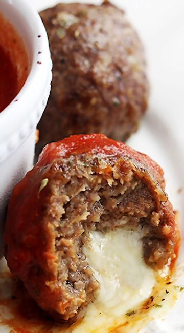 Slow Cooker Mozzarella Stuffed Meatballs ~ Juicy, flavorful Italian style meatballs stuffed with melty mozzarella cheese – perfect for dipping in your favorite marinara or alfredo sauce!