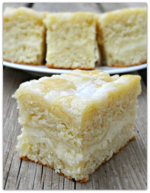 Cream cheese coffee cake recipe ~ The cake is moist and buttery, with a cheesecake like swirl in the middle, some texture from the streusel and sweetness from the powdered sugar glaze