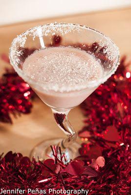 White Chocolate Raspberry Kiss     (1 oz vanilla vodka  1 oz Godiva white chocolate liqueur  1 oz Chambord  1/2 oz white cream de cacao  white chocolate shavings)
