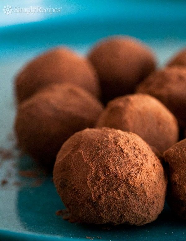 Chocolate Truffles! Easy-to-make chocolate truffles made with chocolate and cream, assorted flavors, and coated with either cocoa or chopped nuts. Perfect for Valentine's Day! Get the recipe on SimplyRecipes.com