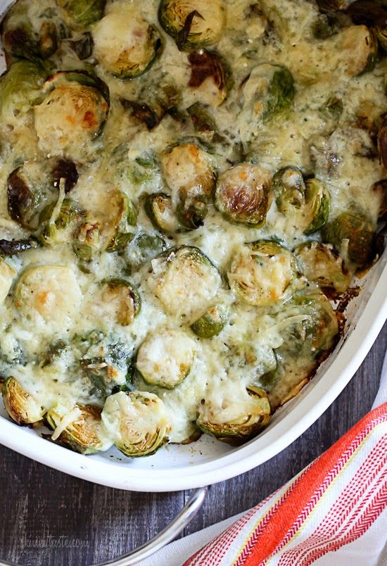 These brussels sprouts are roasted until crisp, then topped with a light cheese sauce made with...