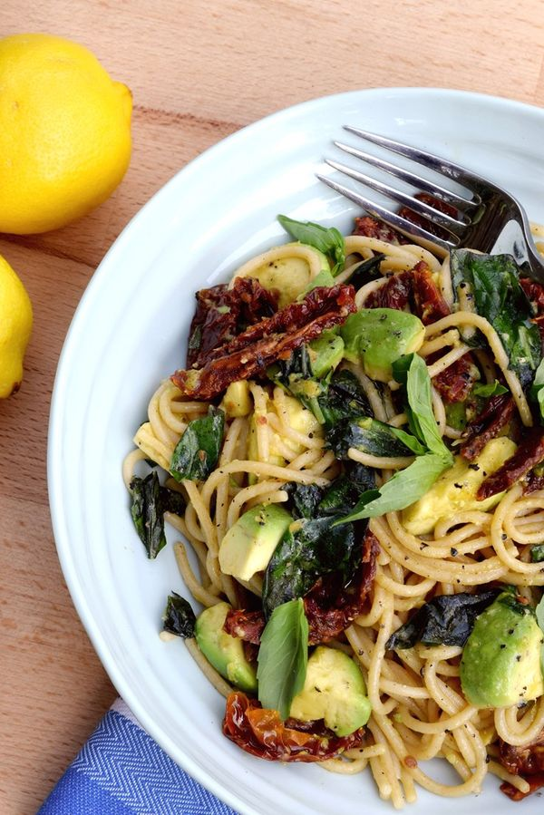 Rachel Phipps serves up a vibrant avocado pasta recipe, dotted with tasty sun-dried tomatoes and plenty of fresh basil.