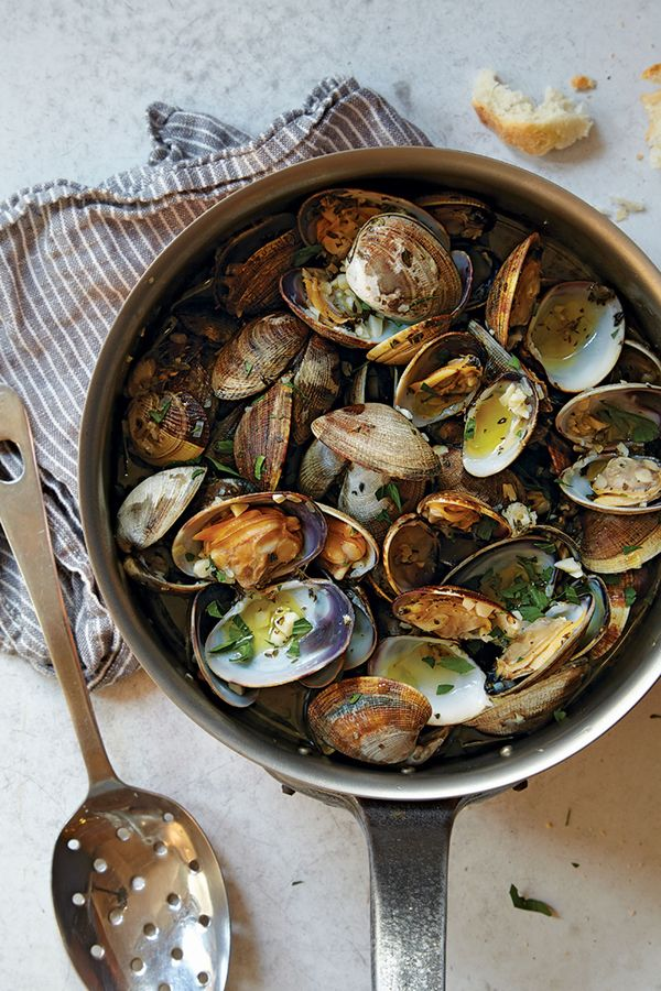 Steamed in white wine, perfumed with garlic and thyme, these clams make an easy and quick weeknight meal. Some crusty bread for dipping and a simple frisée salad round it out.