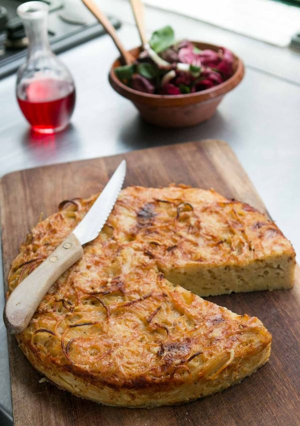 Crusty, cheesy and delicious Spaghetti Pie with 3 kinds of cheese and lots of black pepper!
