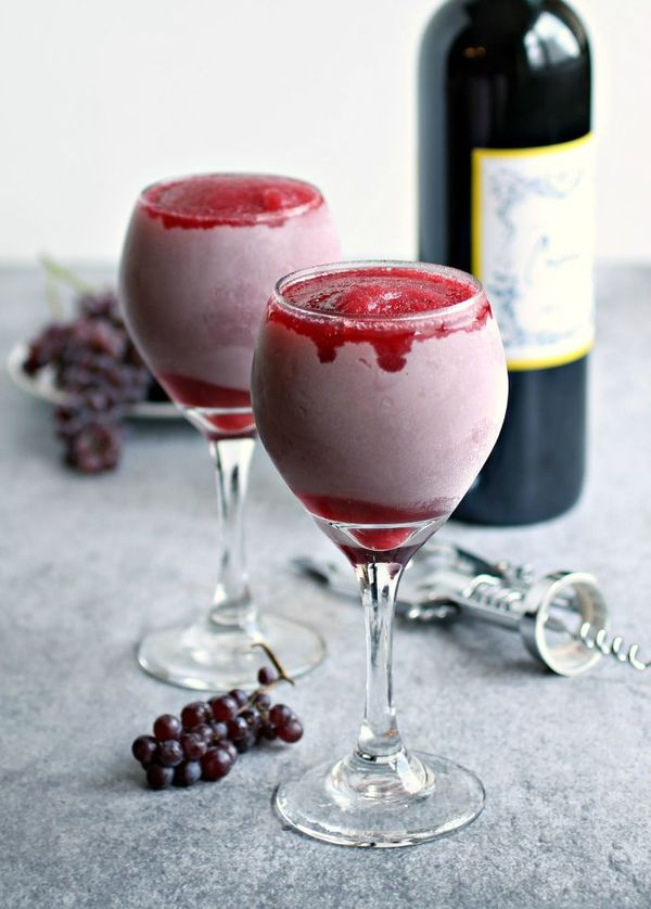 Strawberry Red Wine Slushies [Boil 1 c water with 12 packets of Sweet & low; Blend 1 c frozen strawberries, 1.5 c red wine, and 4 oz syrup]