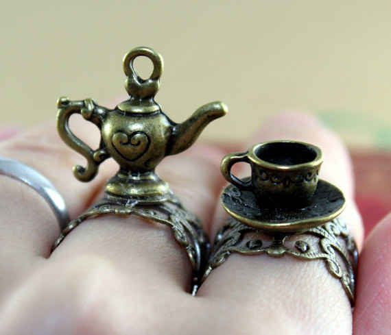 metal teapot and cup rings. | 27 Items All Tea Lovers Need In Their Lives