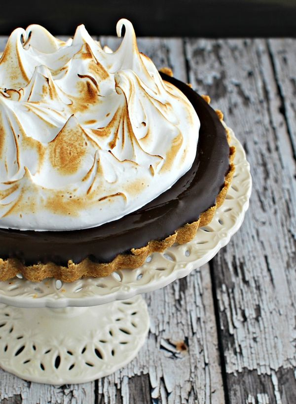 this fabulous chocolate tart is made to taste just like s'mores with a graham cracker crust, silky chocolate filling and toasted marshmallow topping.