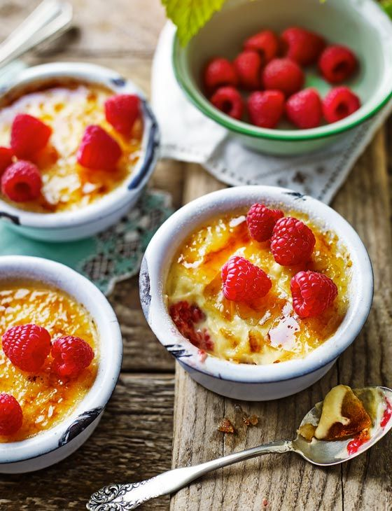 Crema Catalana with raspberries - smooth creamy custard paired perfectly with sweet raspberries make a lovely summer time pudding.
