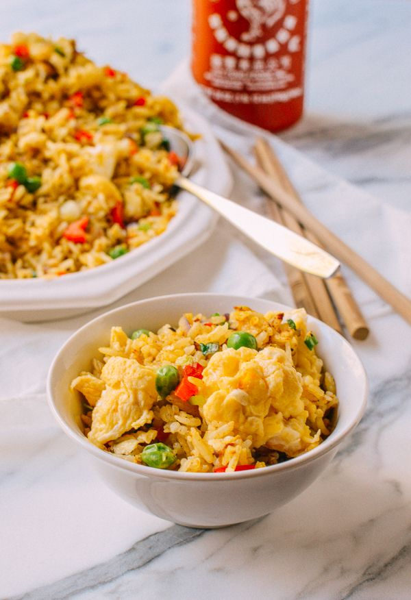 Egg Fried Rice... Deceptively simple, but a huge favorite and crowd-pleaser. My egg fried rice recipe uses egg that's slightly flavored with turmeric and paprika, which I think is a unique addition. It adds color to the dish, making it a vibrant yellow. by thewoksoflife.com