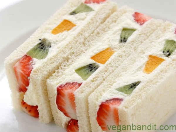 French Vegan Fruit Sandwich -Here is one fantastic idea for a super easy meal: fruit sandwich. It takes only 10 minutes to be prepared. Try it out, it might become one of your favorite breakfast or picnic meals.  Ingredients:  6 bread slices 2 sliced bananas 2 tablespoons pomegranate seeds 1 apple (grated) ½ cup pineapple ...- http://www.veganbandit.net/fruit-sandwich/