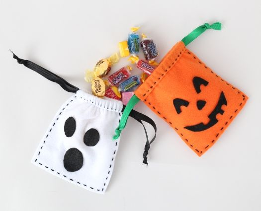 """Make sure everyone gets their share of treats, candies and goodies with the drawstring Felt Halloween Treat bags. Fill them with treats for everyone! Skill Level:Some experience necessary  Approximate Crafting Time: 1 hour SUPPLIES & TOOLS: 1 – 9""""x12"""" CPE Tangerine Felt..."""