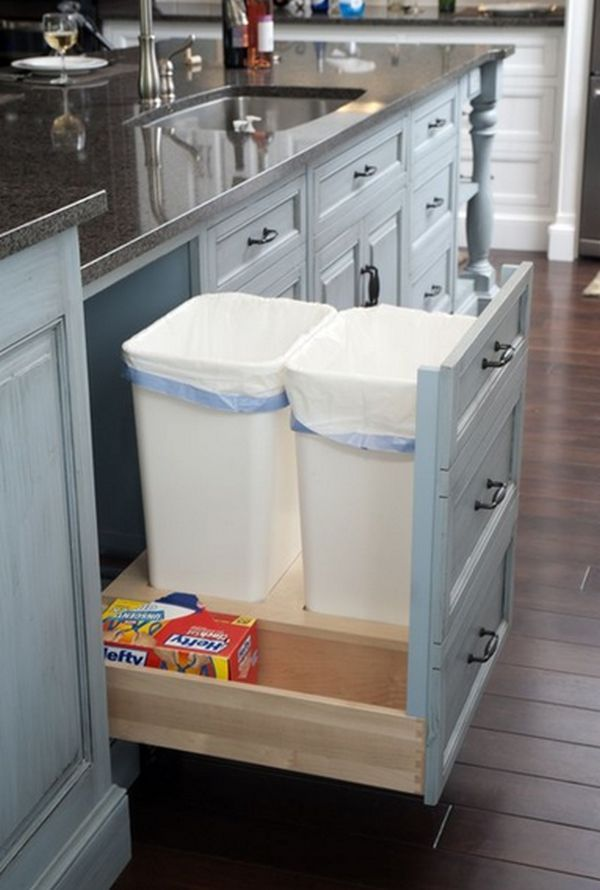20 Best DIY Kitchen Upgrades: 7. Transform a regular cupboard into a pull-out drawer for hidden trash and recycle receptacles for responsible and efficient waste sorting.