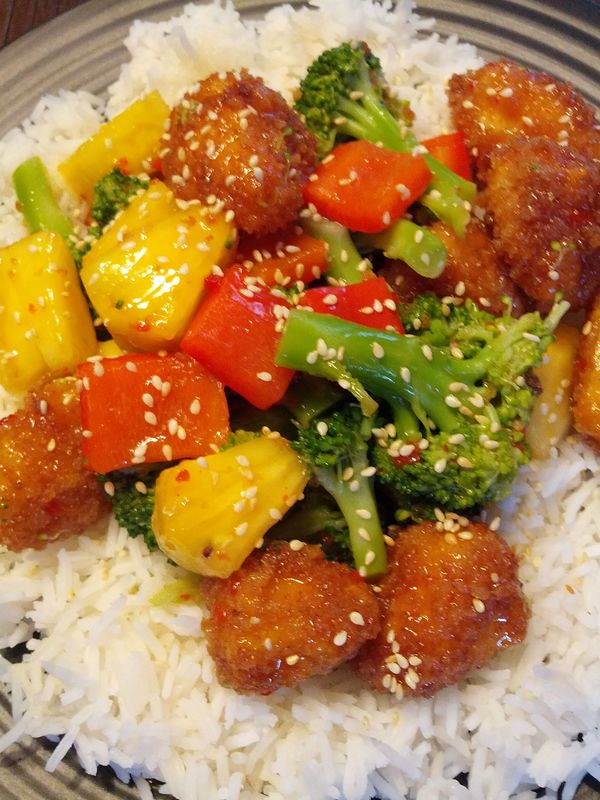 Sweet and Sour Tofu Bites with Fresh Pineapple, Red Peppers, and Broccoli served with Basmati Rice
