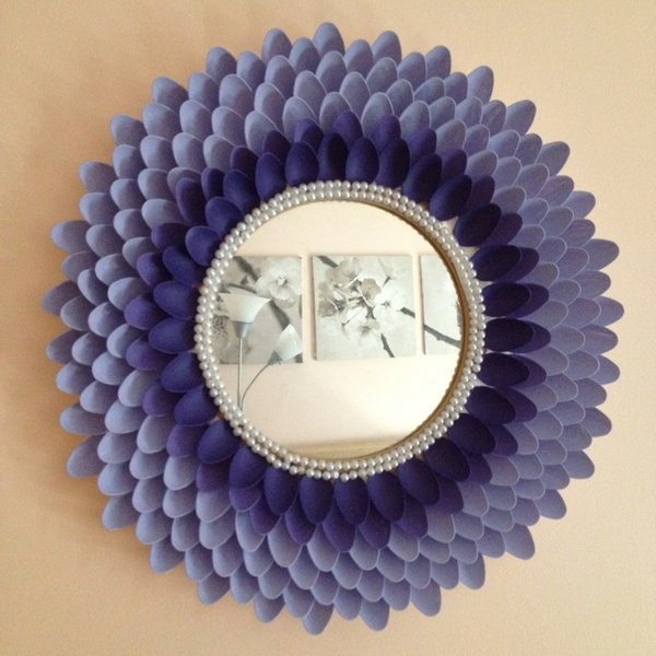 Nikki made a mirror with a pair of pearls, plastic spooQns, and paint!