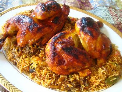 Arabic Food Recipes: Kabseh Chicken (Kabseh bi Djej) Recipe ions, sliced 1 (12 ounce) can tomato puree 2 medium tomatoes, chopped 4 cloves garlic, crushed 2 medium carrots, grated Grated rind of one orange 4 cloves 4 cardamom pods 3 sticks cinnamon Salt and pepper to taste 1 pound long grain rice 1/4 cup raisins 1/4 cup sliced almonds