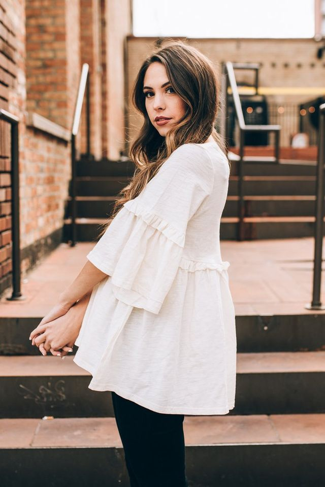 The Bristol Bell Sleeve Peplum in Cream - Model is wearing a small 100% cotton