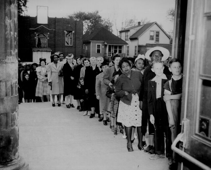 Women picking up their sugar rations.