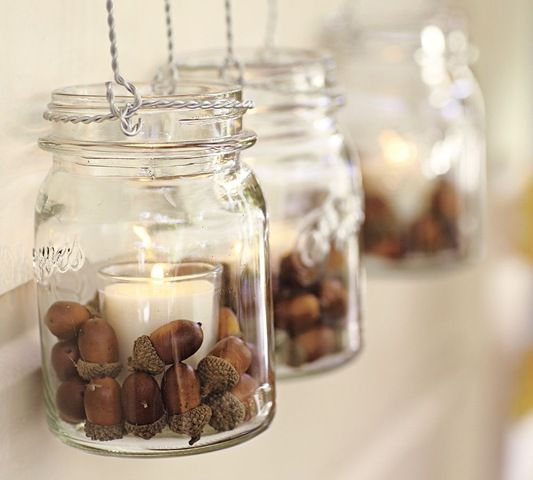 Mason jars with tea lights and acorns