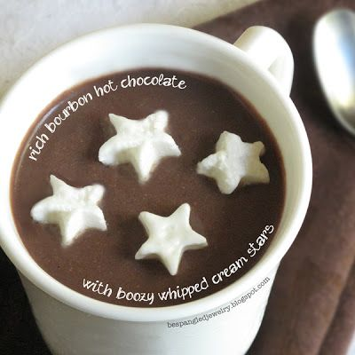 Recipe for rich & delicious bourbon hot chocolate with adorable boozy whipped cream stars. A perfect treat for you and your sweetheart snuggling by the fire!