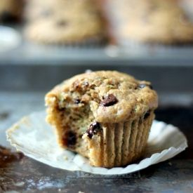 Moist and insanely delicious Skinny Zucchini Banana Chocolate Chip Muffins. Best healthy muffins ever!