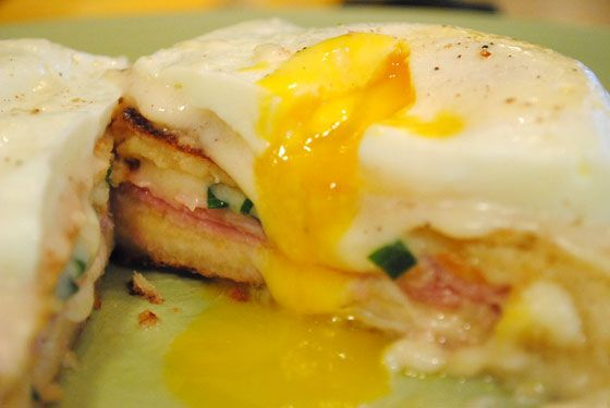 ... Panini with black forest ham, gruyere cheese sauce, fried egg