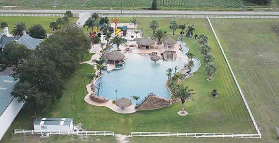 Backyard Lazy River Hgtv :  lazy river, six waterfalls, and last but not least, a bar Photo