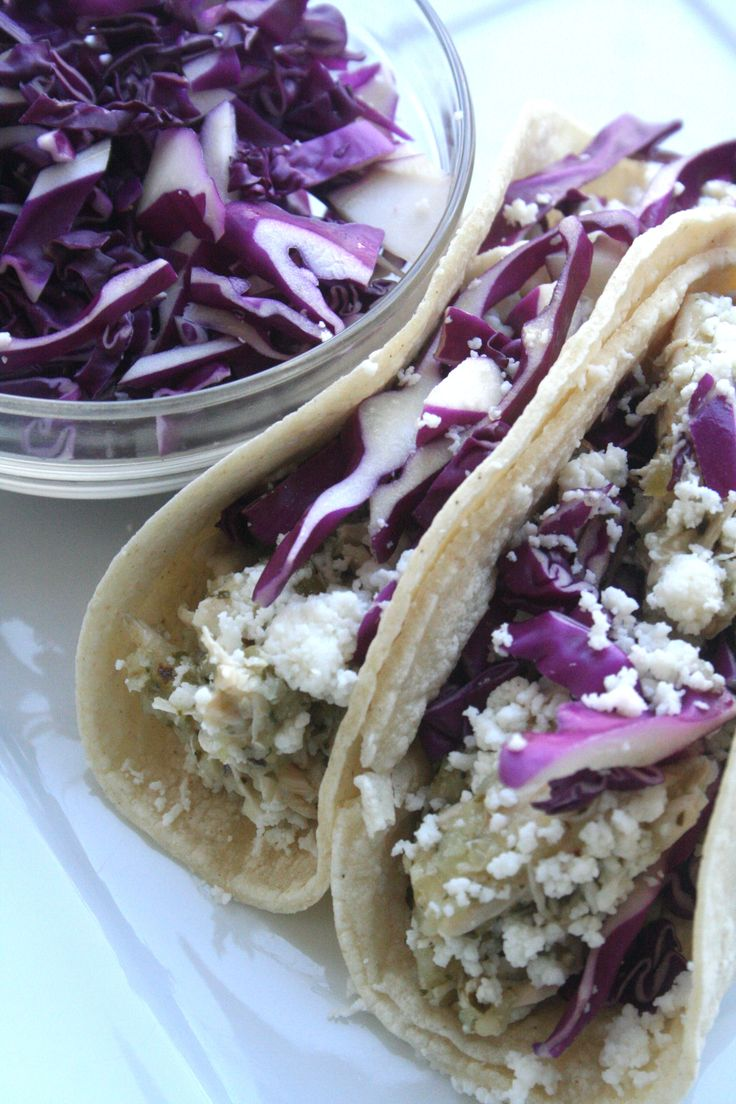 Shredded chicken and tomatillo tacos with queso fresco and red cabbage ...