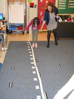 interactive number line...have kids stand on numbers and call out number sentence, then hop up to number and give answer