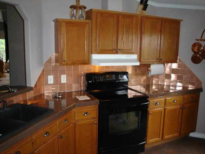 copper backsplash with black appliances it would work with my lt