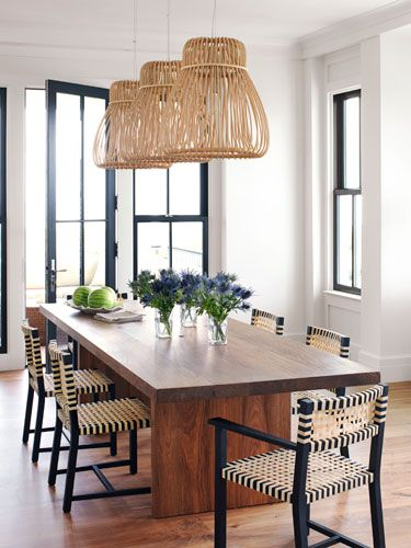 For beachy boldness, designer Sally Markham lit the dining table with rattan Orbita pendant lamps by Tomoko Mizu.
