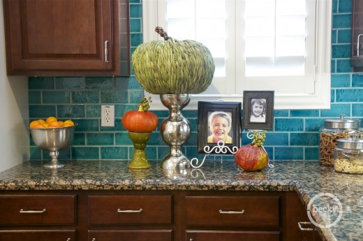color combo in this kitchen Especially the teal blue tile backsplash