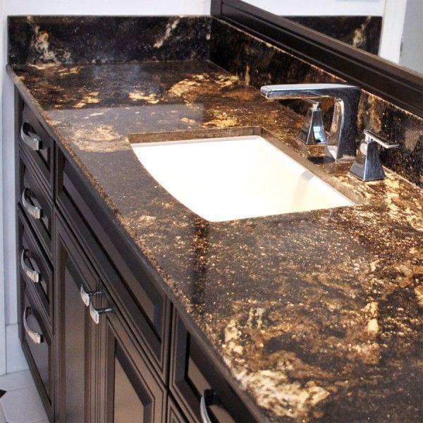 Beautiful bathroom with granite countertops. Saturnia Gold granite ...