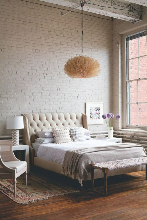 tufted headboard...getting one of these in the future! and love the simplicity of the exposed brick and wood floors with large windows...id love that