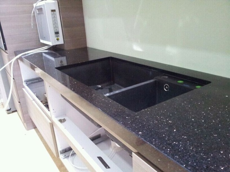 Black galaxy granite kitchen tops countertops pinterest for White kitchen cabinets with black galaxy granite
