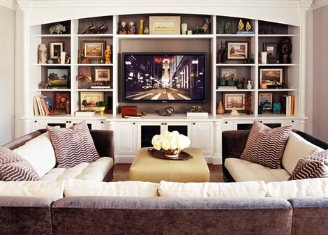 i like the built in shelves with the arch for playroom