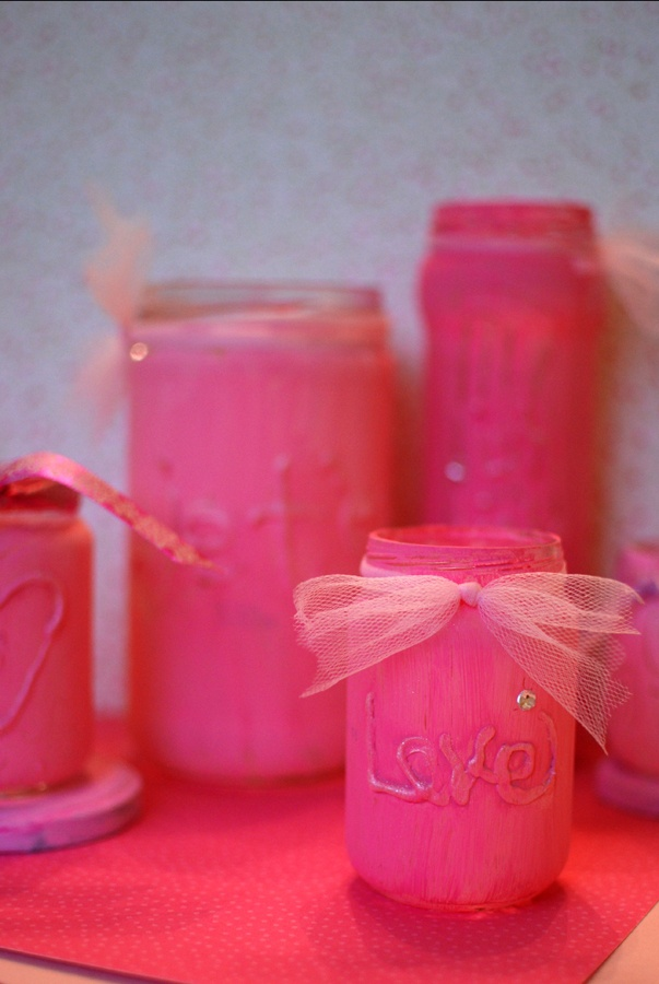 jars + hot glue + pink paint + rhinestones + glitter + ribbon = Valentine's candle holders.