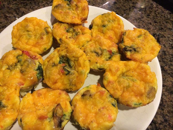 Breakfast egg muffins. I sautéed some chopped red peppers, mushrooms ...