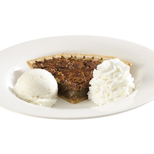 ... pecan pie, served warm with vanilla bean ice cream and whipped cream
