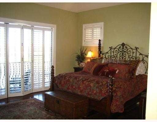 love the shutters over the exit to the patio! refreshing look to heavy curtains!