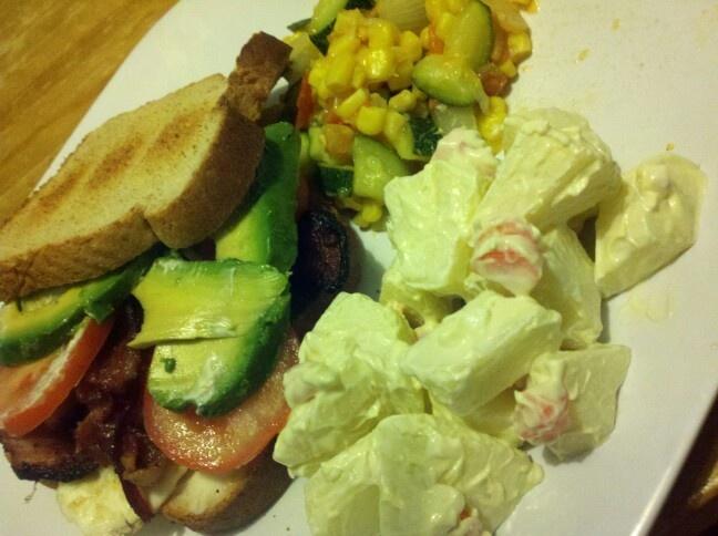 Avocado tomato egg sandwich, apple salad, zucchini corn medley