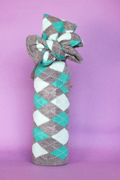 Cute idea.  Wrap a bottle of wine in a pair of knee socks! (In my case, argyle of course)