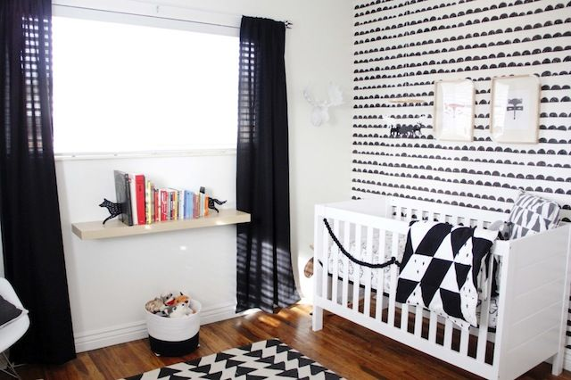 Even though it's black and white, this space feels open, airy and cheerful. #nursery