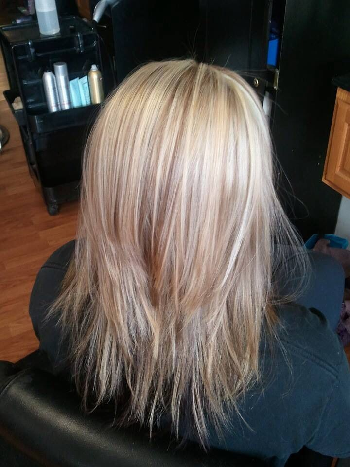 ... hair cut with blonde highlights, caramel low lights and red undertone