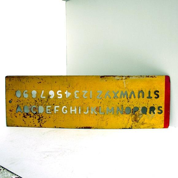 Vintage Alphabet Stencil / Distressed Wood Sign. $38.00, via Etsy.