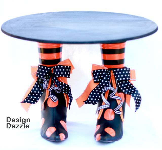 How cute is this cake stand.  Thrift store boots spray painted and Plastic cups for legs