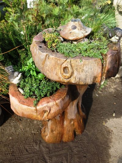 Salvaged broken solar fountain refurbished into a gorgeous fairy garden - love the weathered wood theme...